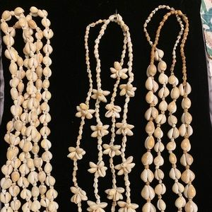 Jewelry - 7 cowry shell necklaces